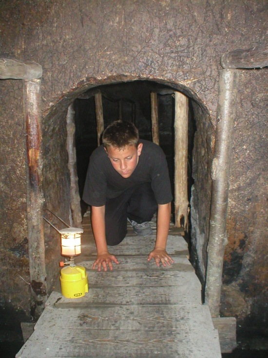 Our son, Chris in 2003, spelunking the Grotta.